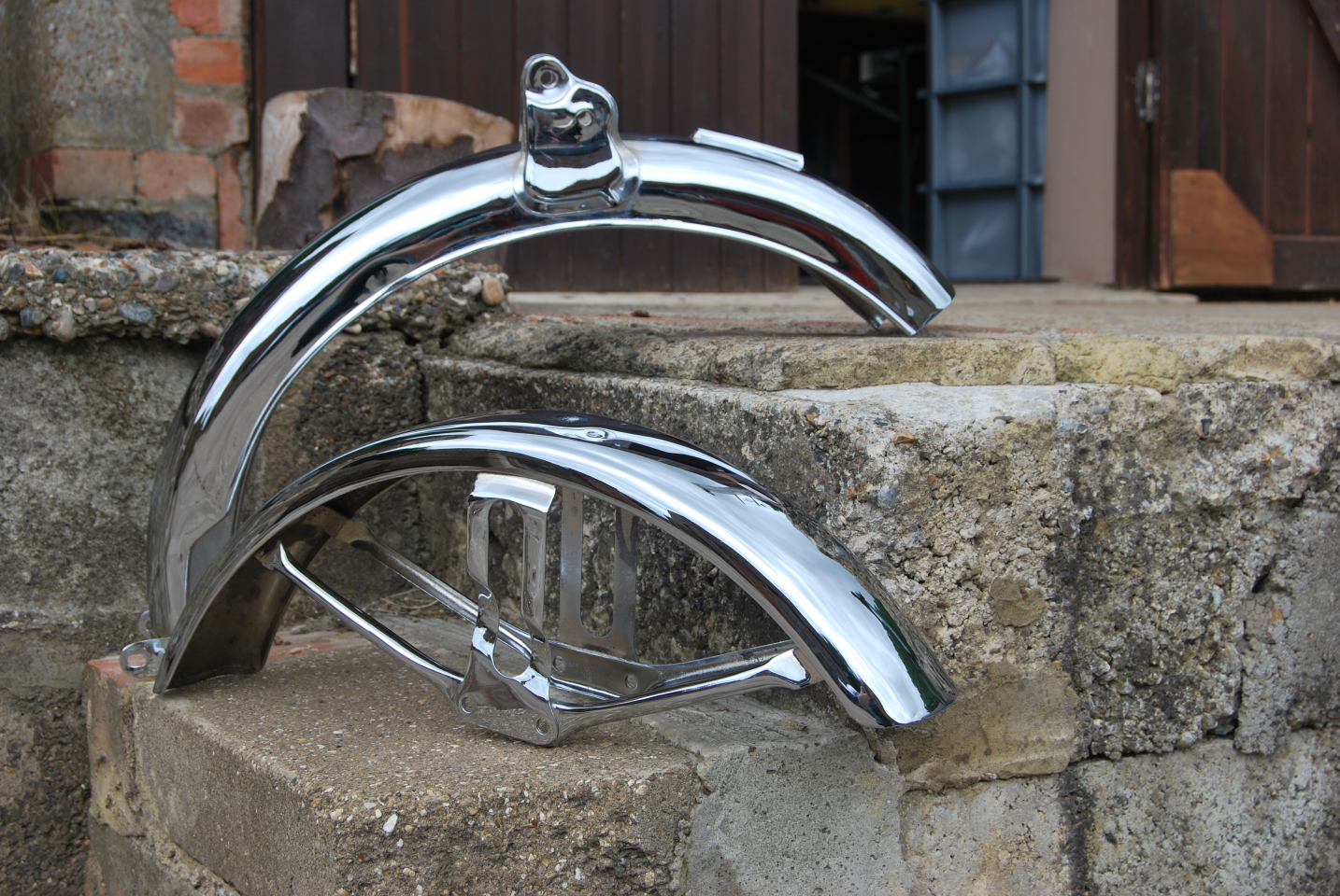 Picture of a motorcycle mudguards re chromed.