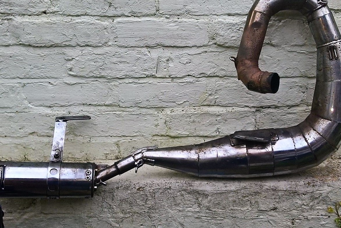 Scooter exhaust from a lambretta before it has been rechromed.