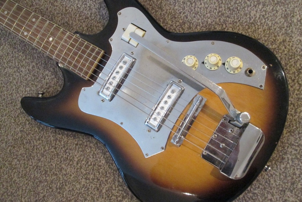 Photo of customers electric guitar with metal parts that require rechroming.